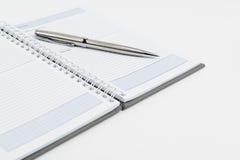 Caderno com pena Imagem de Stock