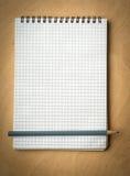 Caderno com pencile em uma madeira Foto de Stock Royalty Free