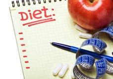 Caderno com plano da dieta Foto de Stock