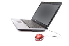 Caderno com rato do computador Fotografia de Stock Royalty Free