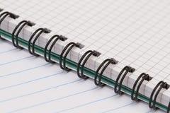 Caderno com uma mola em uma gaiola Fotografia de Stock Royalty Free