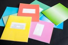 Caderno da escola no preto fotografia de stock