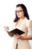 Caderno da leitura da mulher de negócios imagens de stock royalty free