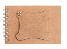 Caderno da placa de Brown isolado no branco Imagens de Stock