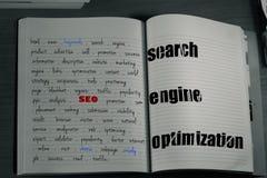 caderno das palavras-chaves do seo fotografia de stock royalty free