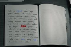 caderno das palavras-chaves do seo foto de stock