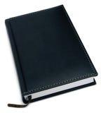 Caderno de couro preto fechado, isolado Fotos de Stock Royalty Free