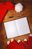 Caderno de Santa Claus para para fazer a lista Fotos de Stock