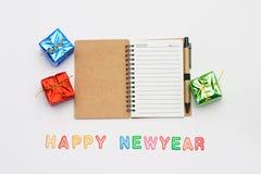 Caderno do ano novo e do Natal com texto Fotografia de Stock Royalty Free
