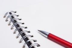 Caderno e bola-pena Fotografia de Stock