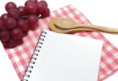 Caderno e colher Imagem de Stock Royalty Free