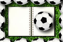 Caderno e futebol Fotografia de Stock