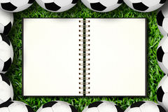 Caderno e futebol fotos de stock
