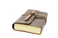 Caderno e lápis fotografia de stock royalty free
