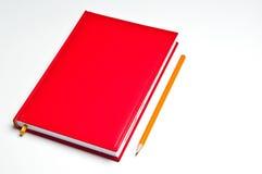 Caderno e lápis foto de stock