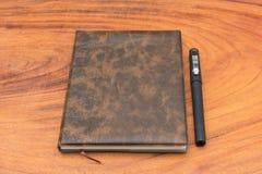 Caderno e pena de Upholstery Fotos de Stock
