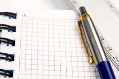 Caderno e uma pena Imagem de Stock Royalty Free