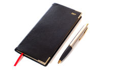 Caderno e uma pena Imagens de Stock Royalty Free