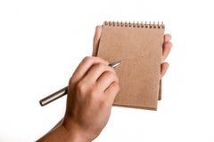 Caderno espiral e uma pena Imagens de Stock