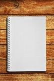 Caderno na tabela de madeira Foto de Stock Royalty Free
