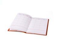 Caderno na tampa vermelha Imagem de Stock Royalty Free
