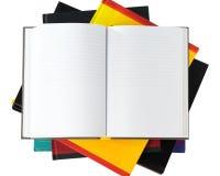 Caderno nos livros isolados no fundo branco Imagens de Stock Royalty Free