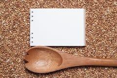 Caderno para a receita sobre o fundo do trigo mourisco Imagem de Stock Royalty Free