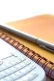 Caderno, pena e telefone Fotografia de Stock Royalty Free