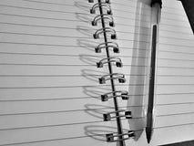 Caderno & pena fotografia de stock