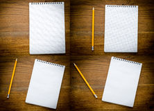 Caderno preto com pencile em um fundo de madeira Fotos de Stock Royalty Free