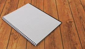 Caderno vazio em um fundo de madeira, espaço da cópia Fotografia de Stock Royalty Free