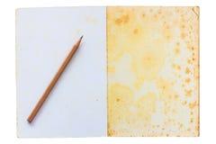 Caderno velho com lápis Imagem de Stock