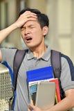 Cadernos chineses novos de With Fever With do estudante masculino imagem de stock