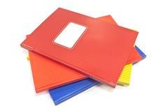 Cadernos coloridos isolados no backgroun branco Fotos de Stock Royalty Free