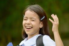 Cadernos de And Laughter With da estudante da criança da minoria da preparação fotos de stock
