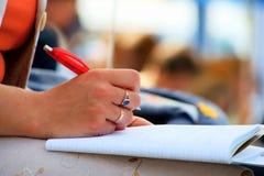 Cadernos e escrita da mão Imagens de Stock Royalty Free