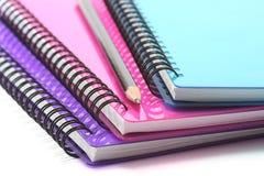 Cadernos e lápis imagens de stock royalty free