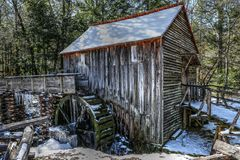 Cades Cove Grist Mill In Winter. The past couple days of ridge weather ices up the flume, and wheel. The Great Smoky Mountains National Park's old Cable Grist Royalty Free Stock Photos