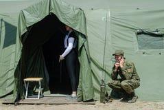 Cadet holds a radio station and communicates Stock Photo