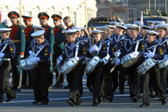 The cadets drummers in naval uniform at the Palace square in St. Saint Petersburg, RUSSIA - MAY 05, 2017: Young drummers of the Nakhimov naval Academy at the Stock Image