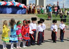 Cadets and girls execute the Cossack dance Royalty Free Stock Photography