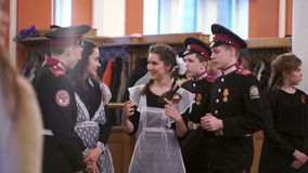 Cadets and schoolgirl communicate in the official party for veterans of World War II stock video