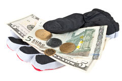 Cadging. Shallow money notes and chinks on a glove are isolated on a white background Royalty Free Stock Image
