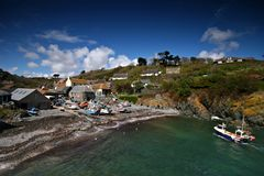 Cadgwith cove Lizard peninsula. Cadgwith cove on the Lizard peninsula is one of the few remaining small Cornish villages that still relies heavily on fishing Stock Image