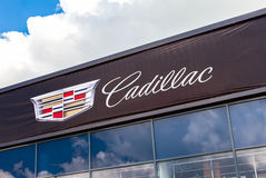 Cadillac automobile dealership sign against the sky Stock Photo