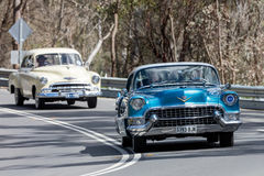 1955 Cadillac Coupe De Ville Coupe. Adelaide, Australia - September 25, 2016: Vintage 1955 Cadillac Coupe De Ville Coupe driving on country roads near the town Stock Photography