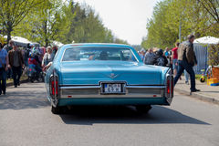 Cadillac Coupe de Ville  drives on street Stock Photography