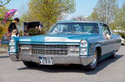 Cadillac Coupe de Ville  drives on street Stock Image