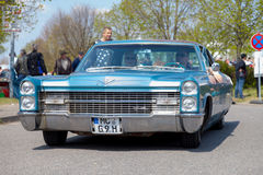 Cadillac Coupe de Ville  drives on street Stock Images