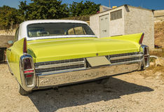 Cadillac de ville vintage car 1950. Wonderfull vintage cadillac car yellow on the road by back stock photo